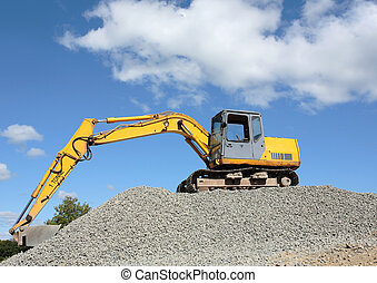 Industrial Digger - Industrial digger standing idle on top...