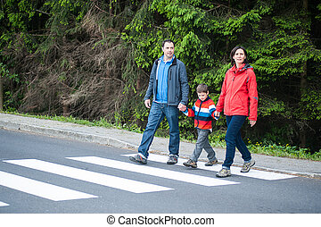 Family crossing the Road - Father and Mother with their Son...