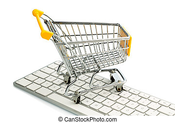 shopping cart and computer keyboard - cart standing on the...