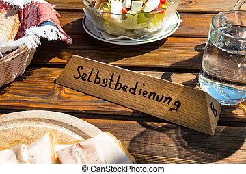 inn sign self - inn sign and self-service food on a table