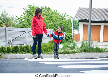 Mother and Son by the Crosswalk - Mother and Son waiting to...