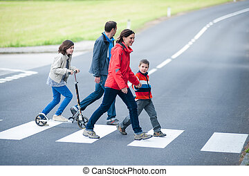 Family walk at the Crosswalk - Young Family walk at the...