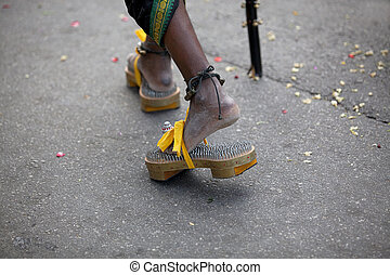 Thaipusam Festival - Devotee walking in the Thaipusam...
