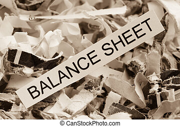 balance sheet of paper - shredded paper tagged balance...