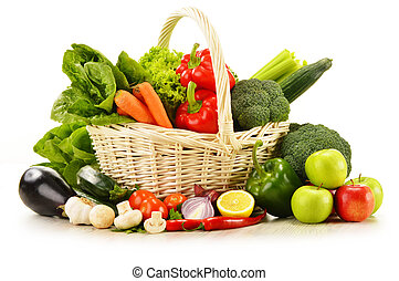 raw vegetables in wicker basket isolated on white -...