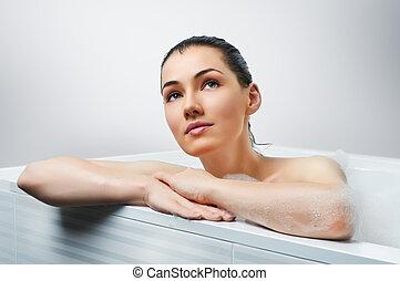 bathroom - beautiful girl lying in the bathroom