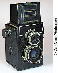 old vitage camera with two lenses on light background