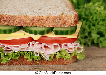 Sandwich with turkey, cheese, tomatoes, lettuce and cucumber