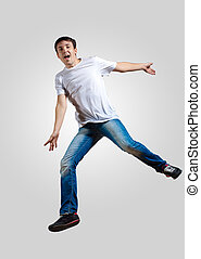 Young man dancing and jumping - Modern slim hip-hop style...