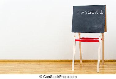 Small blackboard near the wall in empty room