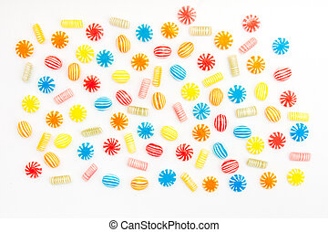 candies - many different color candies on white