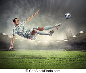 football player striking the ball - football player in white...