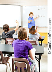 Teaching High School Algebra - Happy teacher instructing a...