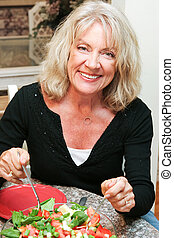 Healthy Middle-aged Woman Eating Salad - Beautiful healthy...