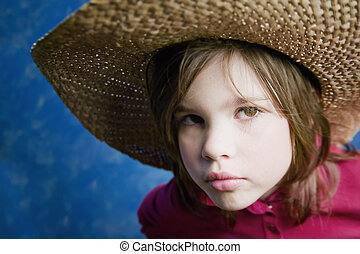 Little girl with a straw hat