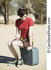 Punk Girl Sitting on Suitcase