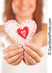 Happy girl in love - Picture of a small white heart in...