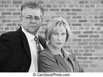 Executive Team - Executive man and Woman Look Confident