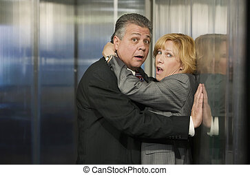 Office Romance - Couple caught in an embrace in a corporate...
