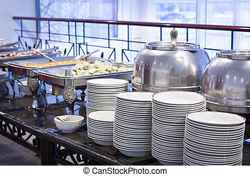 Buffet Table with dishware  - Buffet Table with dishware