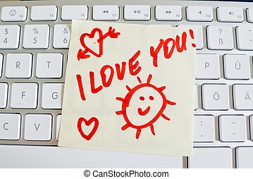 note on computer keyboard: i love you - a memo is on the...