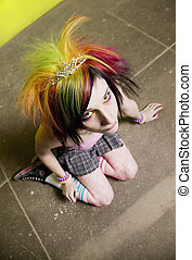 Punk Girl in front of a Green Wall