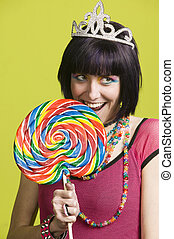 Young punk woman with a big lollipop - Pretty young woman...