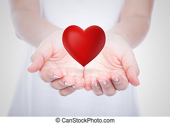 Heart on woman hands over body - Heart on woman hands over...