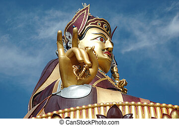 Big golden statue of Padmasambhava or Guru Rinpoche in...