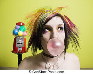 Punk Girl in front of a Green Wall Blowing a Bubble