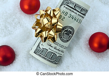 u.s. dollar bills with a bow as a gift of money