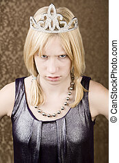 Pretty young girl with a tiara and stern expression