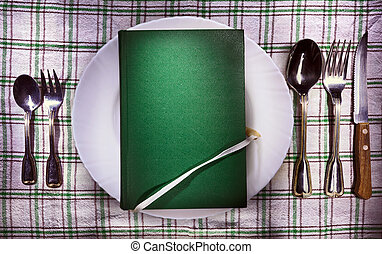 Book on plate - Old green book on white plate, accessories...