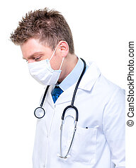 Portrait of male doctor wearing surgical mask - Portrait of...