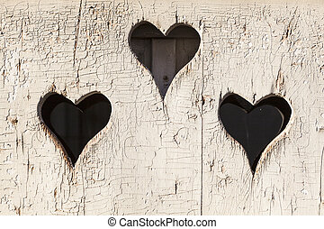 Heart shape look out on wooden door to outhouse. - Heart...