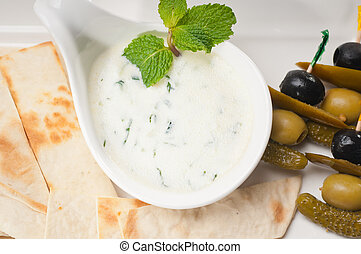 Greek Tzatziki yogurt dip and pita bread - fresh Greek...