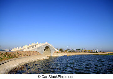 bridges in the lake water, in the blue sky