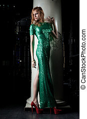 Young red woman in green dress - fashion nightclub - Full...