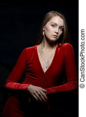 Pretty young woman portrait in red dress
