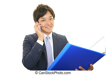 Smart phone and businessman - Businessman talking on smart...