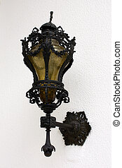 Street lamp on a textured white wall