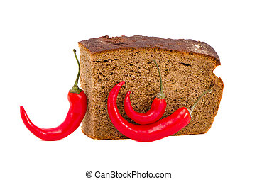 brown bread and red hot chilli peppers isolated on white