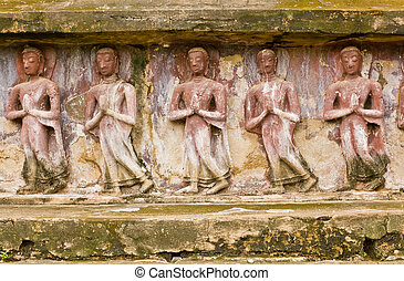 The carving of images of Buddha