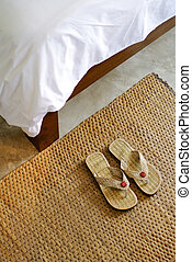 slippers and part of blanket, hospitality concept