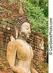 The image of Buddha and the ruins