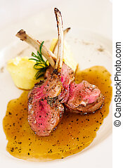 Gourmet Main Entree Course Grilled Lamb steak with spicy...