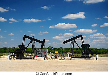 Double Pumping for Black Gold - Two pump jacks operating in...