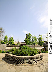 chinese traditional architectural and greening in a park,...