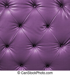 Close up violet luxury buttoned black leather