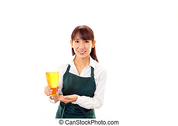 Waitress with glass of beer - Waitress carrying beer